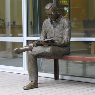 Young Man Reading (view 1)