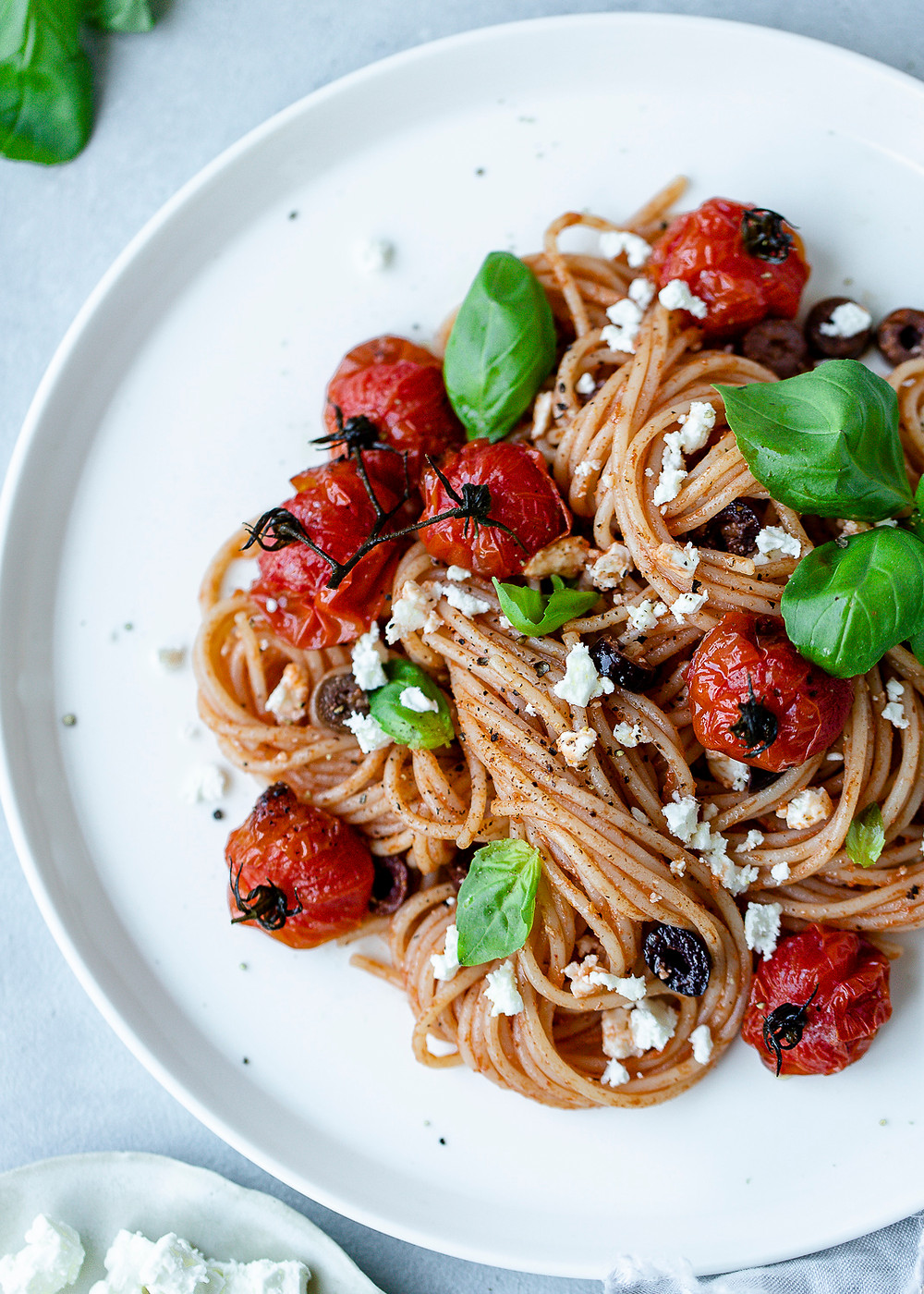 Spaghetti with blistered tomatoes and feta