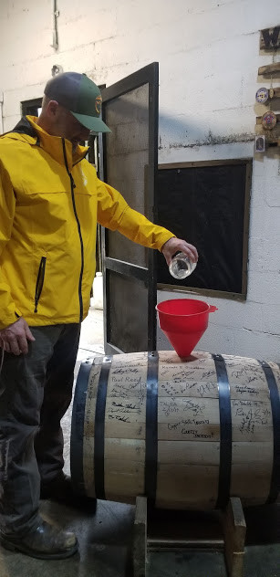 Captain Nathan filling a barrel at Glenn's Creek Distillery.