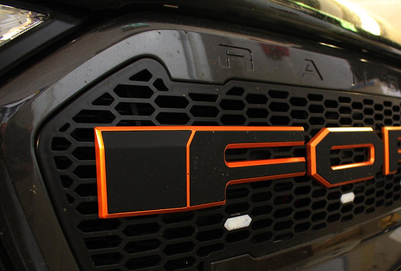 Front Mesh Grille With Black and Orange Letters