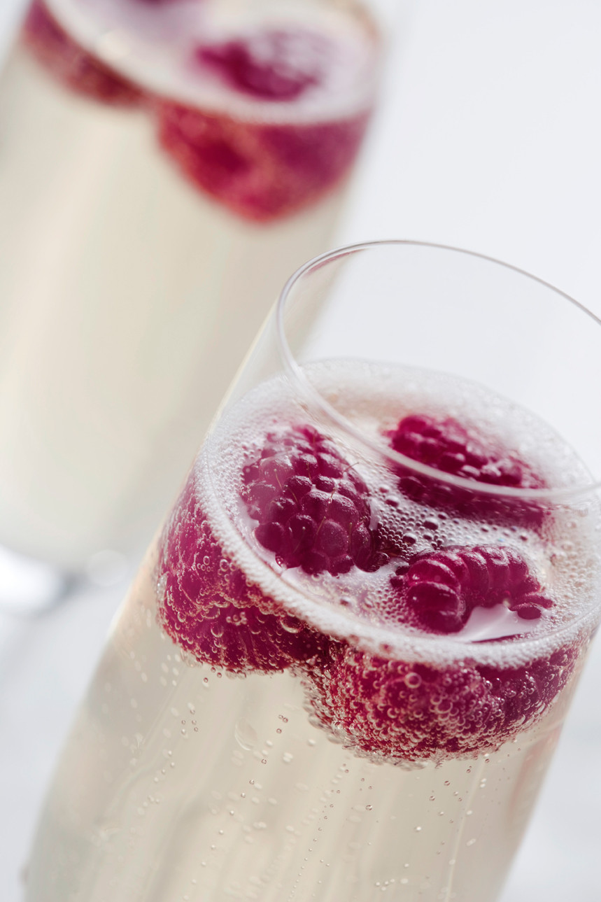 Champagne with fresh raspberries