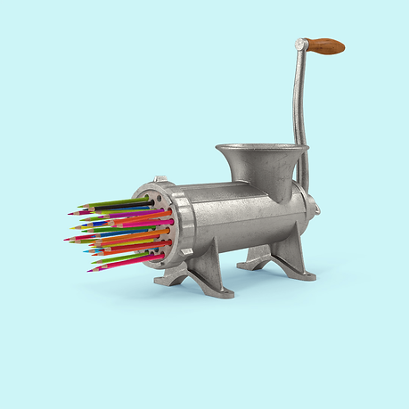 Meat grinder with pencil crayons.