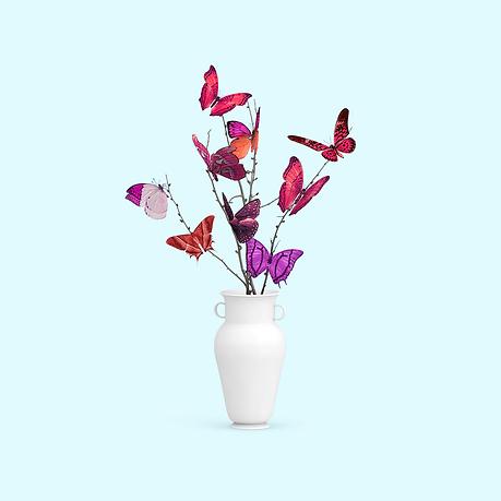 Butterflies as flowers in a vase.