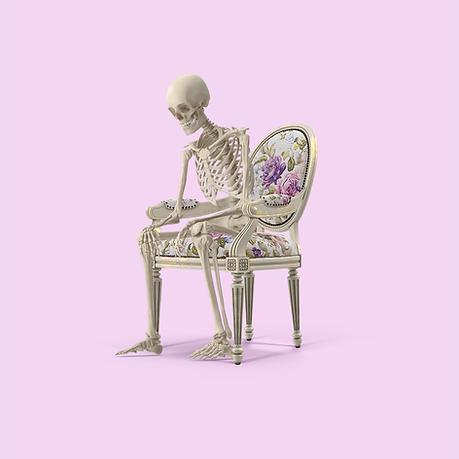 Skeleton sitting on chair.