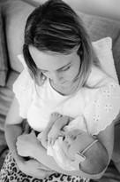 Newborn mum hugs .jpg