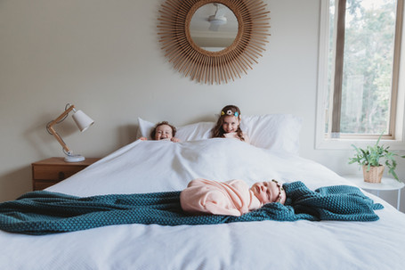 fun newborn family photos.jpg