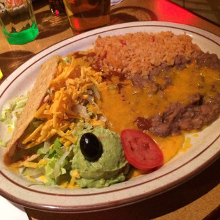 Taco and enchilada with guacamole