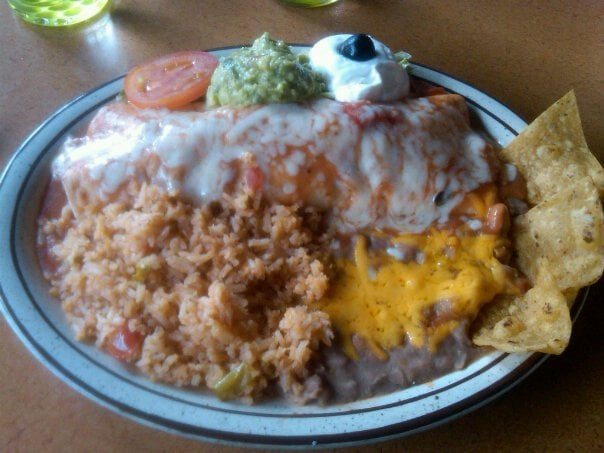 Chicken Burrito served with Rice, Beans, Guacamole, and Sour Cream