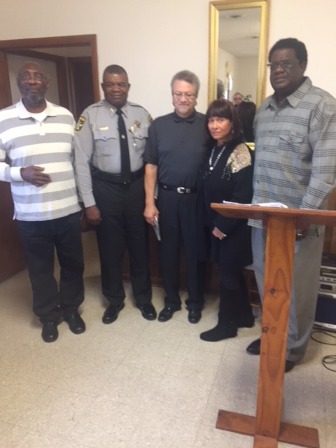 The Rev. Jimmy Gordon, assistant Community Watch clergy; Sheriff Lewis Hatcher, Vincent Spaulding, chief operating officer of the George Henry White Memorial Center; Wanda Campbell Clay, a descendant of Mrs. Mattie Campbell who donated the building and land; and Dr. Alphonse Turner, Community Watch Chief Clergy, left to right.