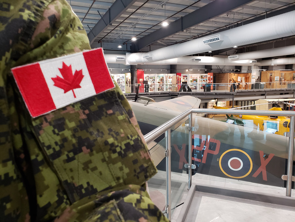 Canadian uniform and flag with the Halifax in the background