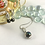 Thumbnail: Silver Pendant Necklace, set with a Black Pearl surrounded by CZ