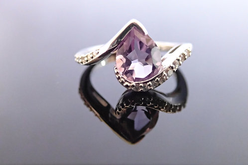 Silver Ring, set with Pear Shaped Amethyst and CZ