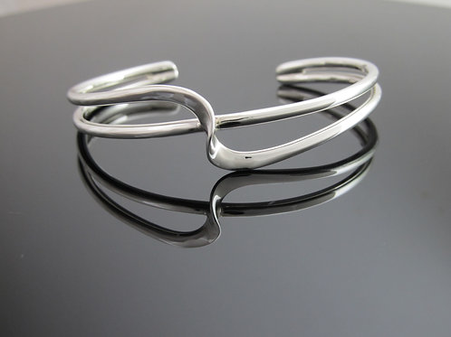 contemporary sterling silver torque bangle