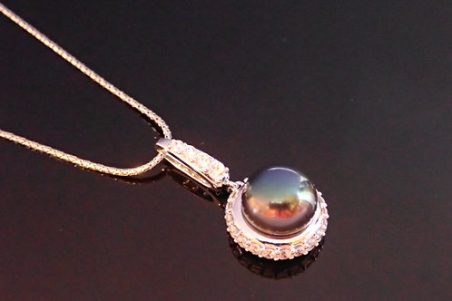 Silver Pendant Necklace, set with a Black Pearl surrounded by CZ