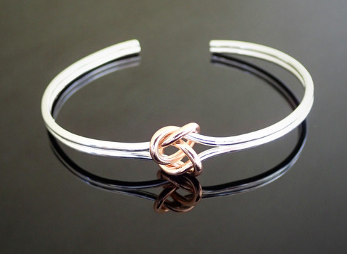 828bba4a771e Silver Torque Bangle with Rose Gold Plated Knot - Sterling Silver