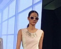 Model with chris lewis symmetrical necklace on