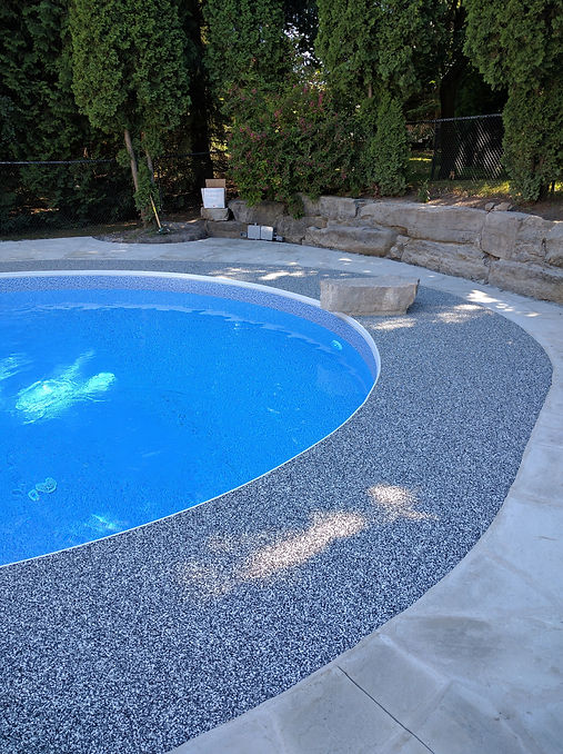 Blue rubber mixture on a pool deck to match the pool liner