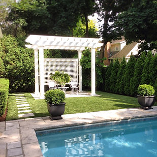 Artificial grass around natural stone pool for soft and beautiful comfort