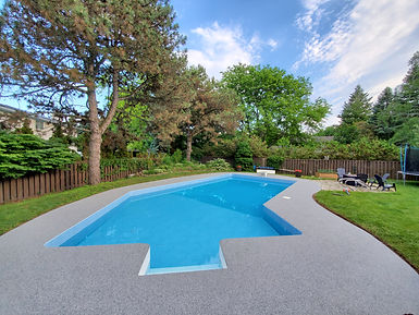 Pool deck covered with smooth and seamless, non-slip rubber surfacing