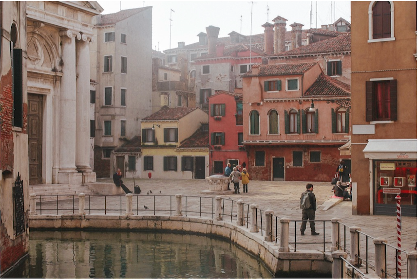 Another street view in Venice, taken on the same hazy morning as some of my other photographs, midway over a bridge. We were in the real heart of the city. The majority of Venice seemed to be mostly linear streets and straight canals, I loved the curve and weaving nature of this area, combined with the warm colours of the stacked architecture in the background which make up the narrow Italian streets - very authentic to this place. I think studying architecture you're trained to be very aware of forms, structures, light, shadow and mostly the way people use spaces, and I think this image is a nice testament to that.