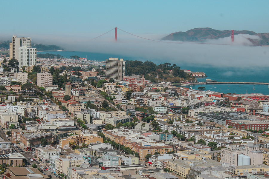 From Telegraph to Russian Hill, the Presidio of San Francisco, with a mid morning fog rolling over the Golden Gate Bridge and Marin Headlands.