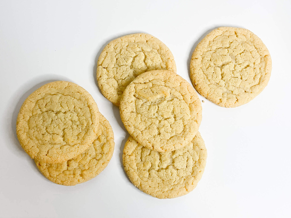 6 sugar cookies on white background