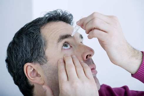 Man using eye lotion.jpg