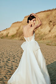 Open back bridal gown with bow.jpeg