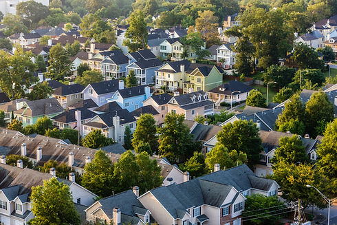 Aerial view of house roofs in suburban n