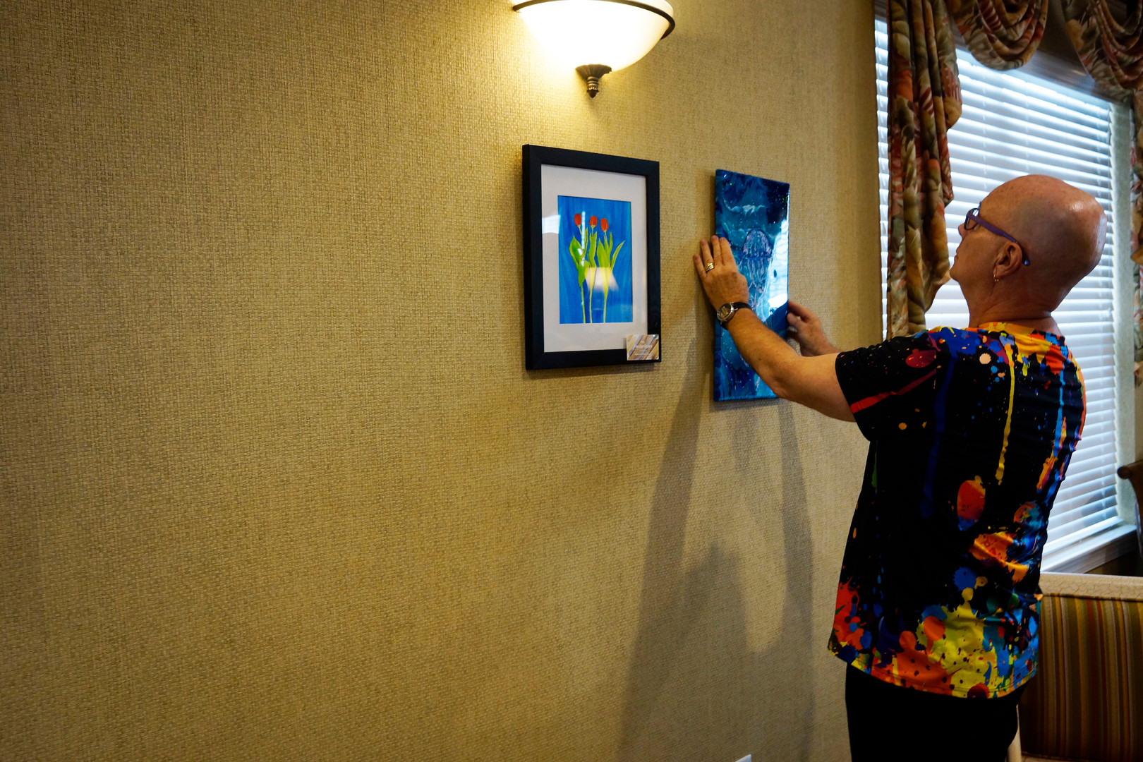 Phred Madsen-Vallee hanging artwork at Brennity Gallery