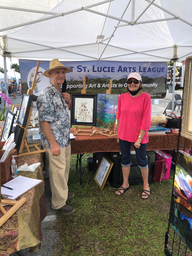 Randy Lenna (left) Jill Heveron (right)  volunteering to welcome visitors at the non-profit boot - sharing info about the leagueand it's mission.