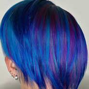 Darker hair colour-lifted in three sessions, with blue and purple colour added after deep conditioning