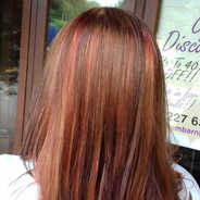 Creative brown, red and orange colour combination by the salon owner