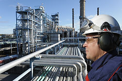 refinery worker with large petrochemical