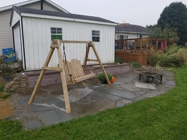 Small Flagstone Patio with Retaining Wall