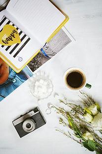 photo-of-diary-beside-a-coffee-mug-36936