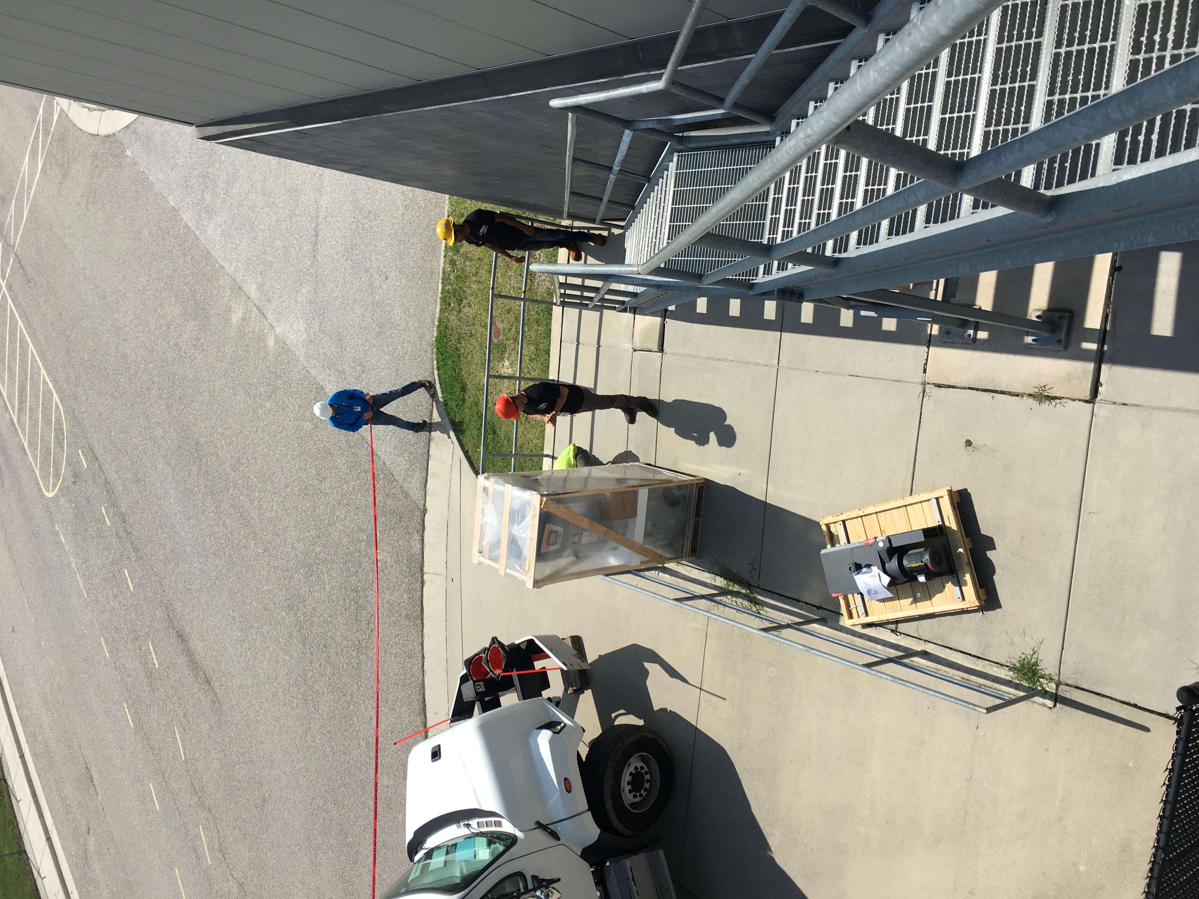 Using crane to lift water heater