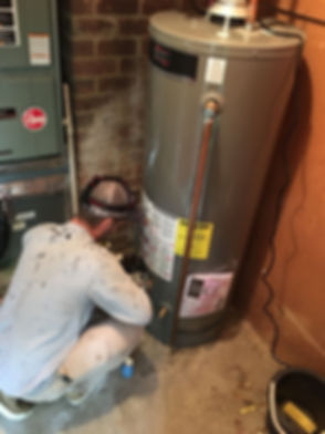 Anthony replacing a water heater