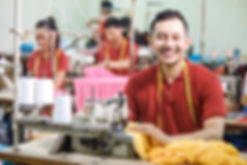 portrait of asian worker in textile fact