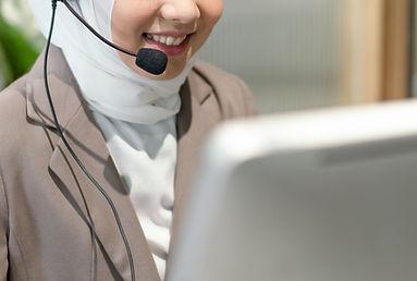 smiling-beautiful-muslim-woman-working-care-customer-service-wearing-headphone-talking-wit