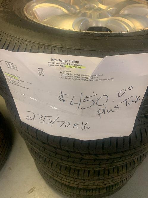 2002 Mazda Tribute- (4) 235/70/R16 tires with aluminum rims