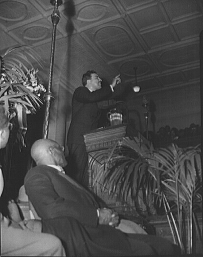 Powell addressing a meeting