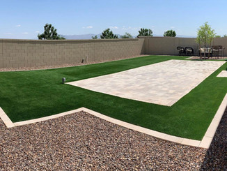 Backyard Design with Synthetic Grass, Pavers, & Rock
