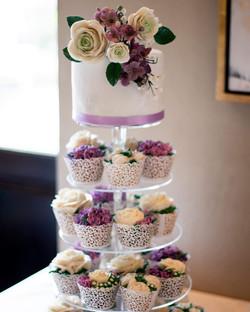 "6"" fondant wrapped vanilla, 48 floral cupcakes, gumpaste topper $460"