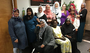 a group of women, most wearing hijabs