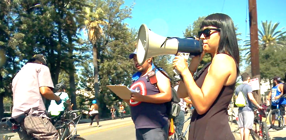 A woman at a demonstration with a megaphone