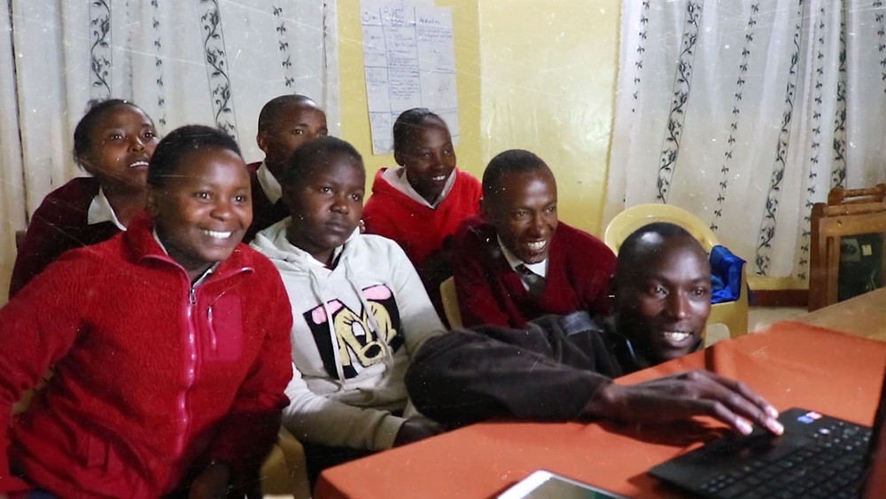 A group of students from Kenya and Tanzania check into a group video chat.