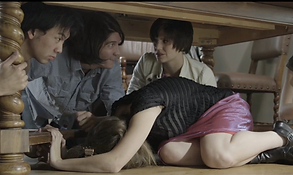 four people hide under a table
