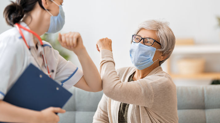 Doctor and senior woman wearing facemasks during coronavirus and flu outbreak. Virus prote