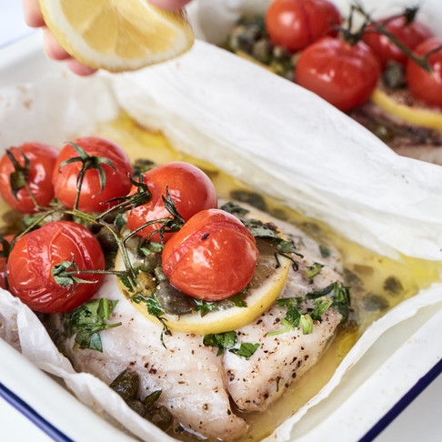 Fish Parcels with Fresh Herbs and Cherry Tomatoes on the Vine